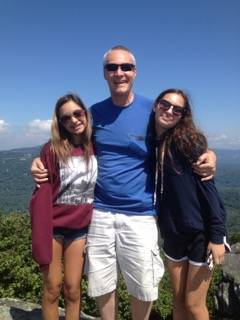 At Grandfather Mountain in Linville, North Carolina, with Brittany, left, and Tiffany in August 2014. 'It was the last time I saw Brittany alive,' Russell says. Tiffany visited the Cofflands alone the next year.