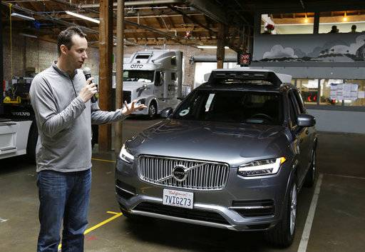 FILE - In this Dec. 13, 2016, file photo, Anthony Levandowski, head of Uber's self-driving program, speaks about their driverless car in San Francisco. Uber is threatening to fireLevandowski, accused of stealing self-driving car technology from a Google spin-off unless he waives his constitutional right against self-incrimination so the ride-hailing service can comply with a court order. Waymo, a self-driving car company started by Google, alleges Levandowski downloaded 14,000 documents containing its trade secrets before he founded his startup.