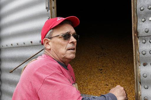 In this Tuesday, April 4, 2017, photo, Blake Hurst, a corn and soybean farmer and president of the Missouri Farm Bureau, stands by a corn silo on his farm in Westboro, Mo. U.S. President Donald Trump has vowed to redo the North American Free Trade Agreement, but NAFTA has widened access to Mexican and Canadian markets, boosting U.S. farm exports and benefiting many farmers. Hurst says NAFTA has been good for his business and worries that he'll lose out in a renegotiation.