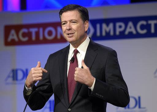FILE - In this May 8, 2017, file photo, then-FBI Director James Comey speaks to the Anti-Defamation League National Leadership Summit in Washington. The White House is disputing a report that President Donald Trump asked Comey to shut down an investigation into ousted national security adviser Michael Flynn.
