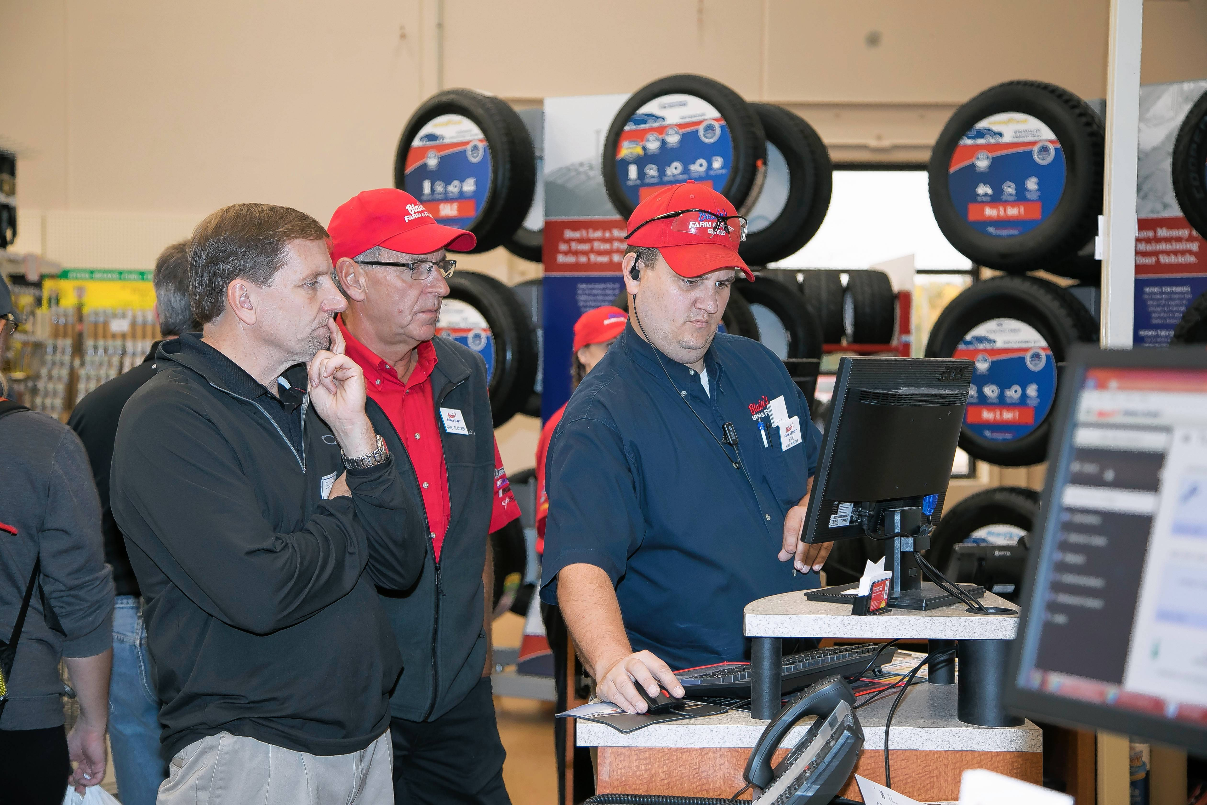 Automotive department workers help a customer at Blain's Farm & Fleet's grand opening last fall in Elgin.
