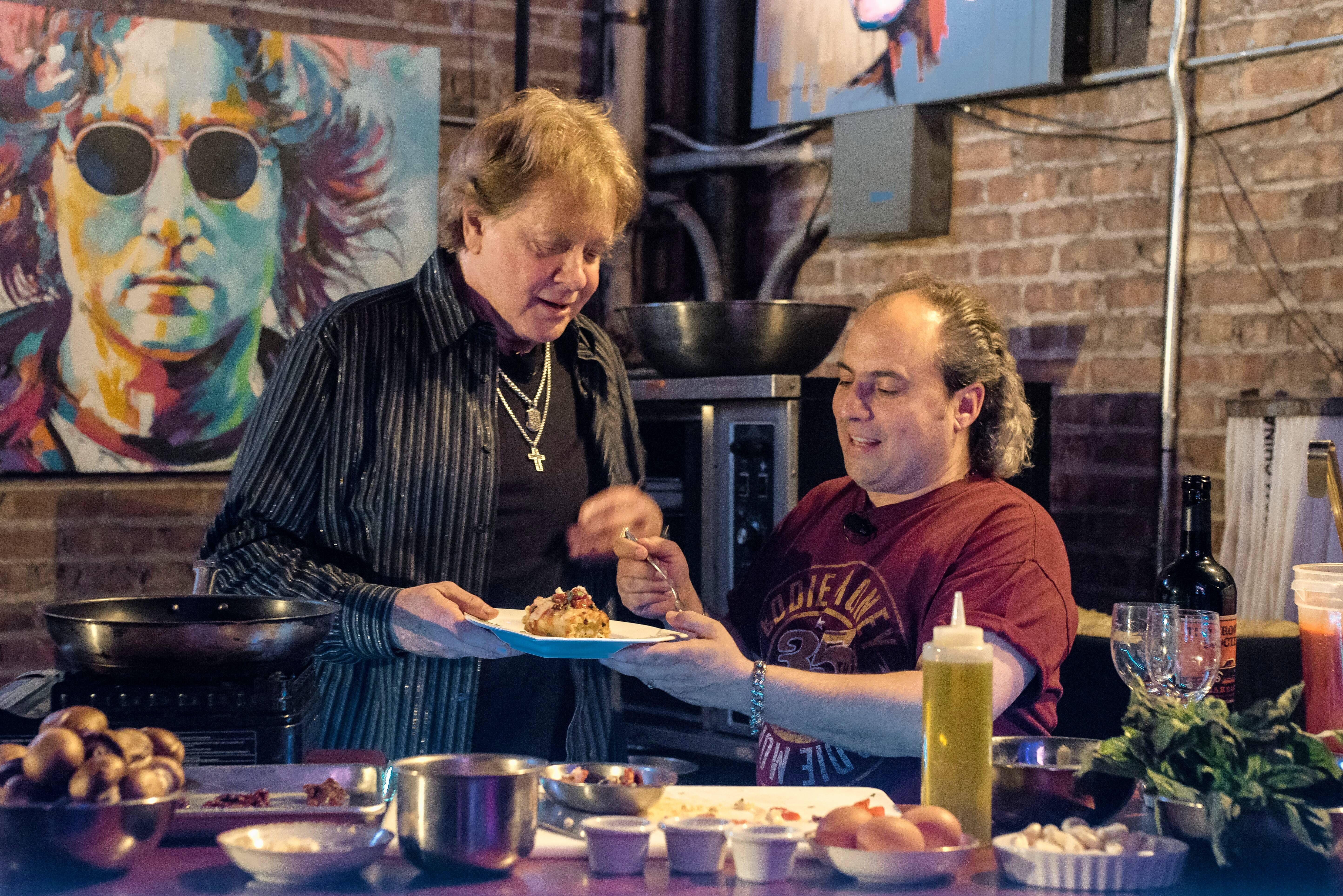 Ron Onesti, right, and singer Eddie Money cook up a vegetarian lasagna.
