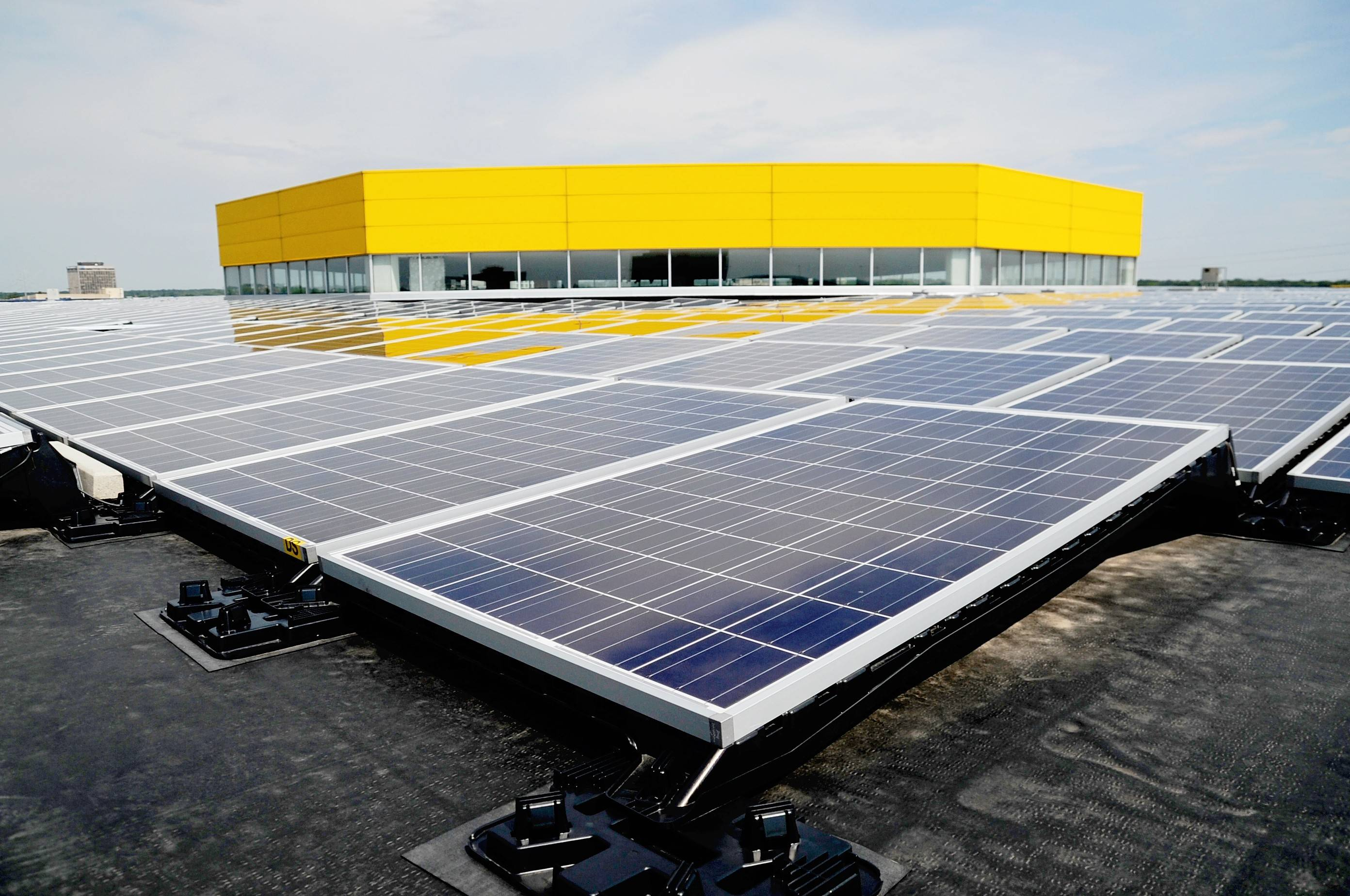 Solar energy panels line the roof of the Ikea store in Schaumburg. ComEd officials said the electric utility will make a major push over the next 13 years to increase the amount of electricity generated from solar energy, the next step following the company's completion of the smart grid system.