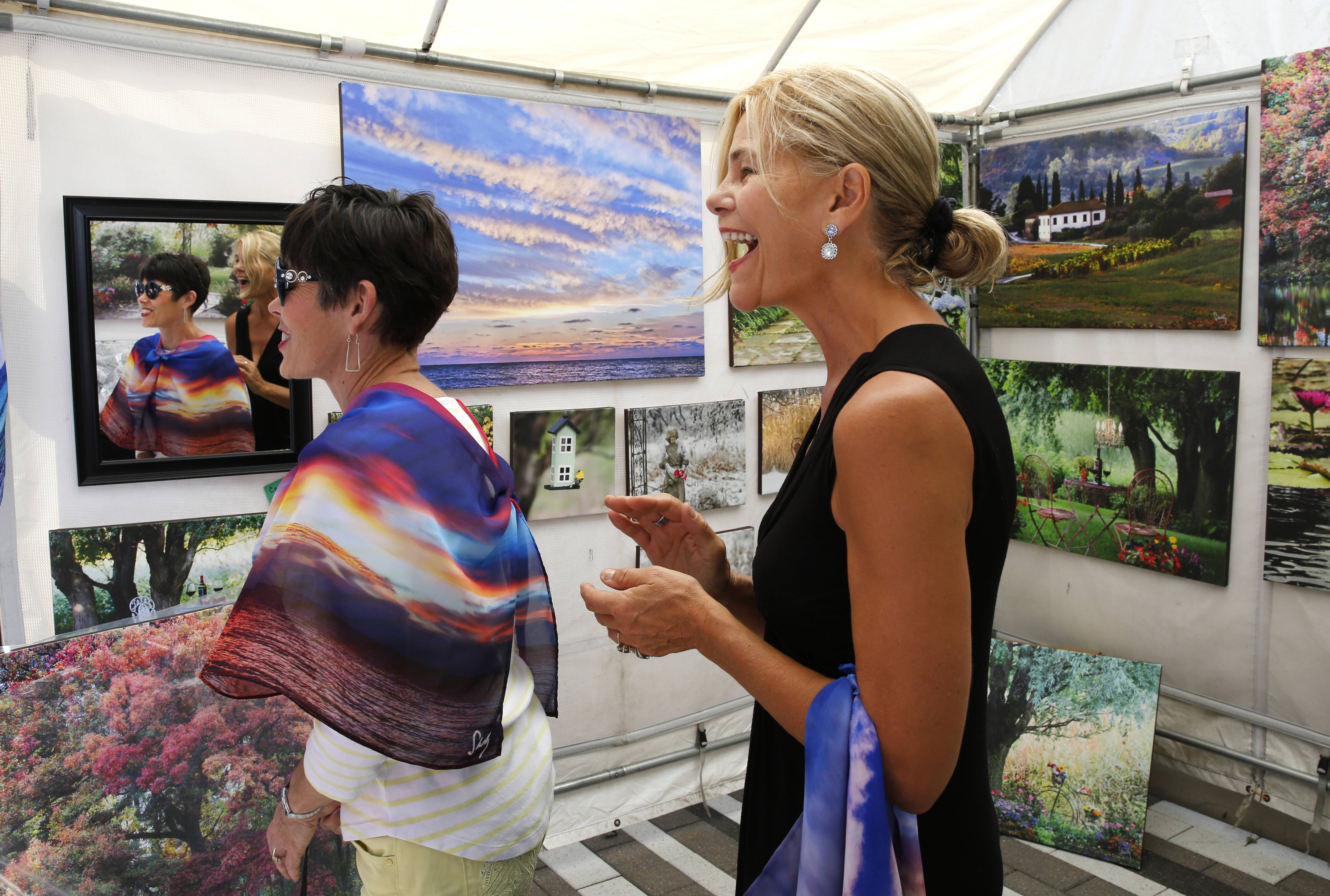 Photographer Shelly Lawler of Hoffman Estates, right, sells photos on canvas and also has begun transferring her landscape images to scarves and other wearable art. She'll be among about 70 artists at the Fine Art Festival at Oakbrook Center.