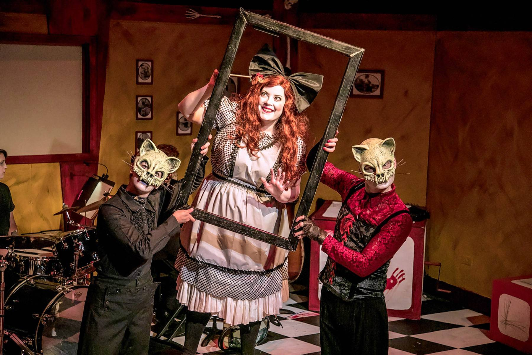 "Harriet (Caitlin Jackson), center, seen here with curious cats (Genevieve Lerner, left, and Kevin Webb) learns how dangerous matches can be in Black Button Eyes Productions' revival of the musical ""Shockheaded Peter."" It plays Chicago's Athenaeum Theatre through Sept. 16."
