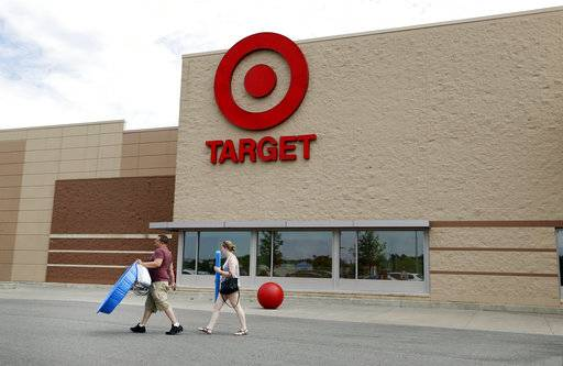 In this Monday, June 27, 2016, photo, customers walk with their purchases from a Target store, in Methuen, Mass. Target Corp. reports earnings, Wednesday, Aug. 16, 2017. (AP Photo/Elise Amendola)