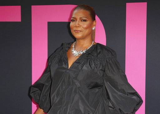 "FILE - In this Thursday, July 13, 2017, file photo, Queen Latifah arrives at the World Premiere of ""Girls Trip"" at the Regal L.A. Live in Los Angeles. Queen Latifah will be honored at Diddy's fourth annual REVOLT music conference in October 2017, where performers include Lauryn Hill and 2 Chainz. Latifah will receive the Icon Award for her accomplishments in music, film, TV and more. (Photo by Willy Sanjuan/Invision/AP, File)"
