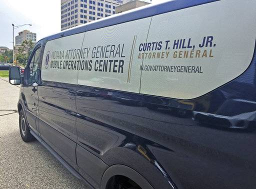 In this recent photo, the new Indiana Attorney General mobile operations center van is parked in Indianapolis. Some state officials are questioning the Indiana Attorney General Curtis Hill's decision to spend about $300,000 on renovating his Statehouse office and buying a van to serve as a mobile office. The van cost nearly $31,000 and is emblazoned with decals that cost another $667 and sport Hill's name. (Tony Cook/The Indianapolis Star via AP)
