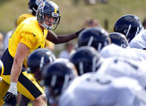 Pittsburgh Steelers linebacker T.J. Watt, left, lines up in drills during NFL football training camp in Latrobe, Pa., Wednesday, Aug. 16, 2017. The rookie linebacker had two sacks in his preseason debut last week, leaving both the Steelers coaching staff and older brother J.J. impressed.(AP Photo/Keith Srakocic)