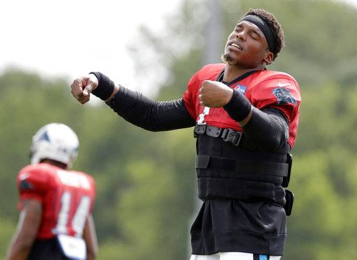Carolina Panthers quarterback Cam Newton dances between drills during a combined NFL football training camp with the Tennessee Titans Wednesday, Aug. 16, 2017, in Nashville, Tenn. (AP Photo/Mark Humphrey)