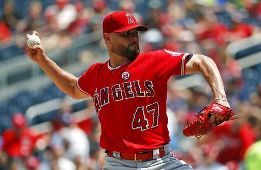 Los Angeles Angels starting pitcher Ricky Nolasco throws during the third inning of an interleague baseball game against the Washington Nationals at Nationals Park, Wednesday, Aug. 16, 2017, in Washington. (AP Photo/Alex Brandon)