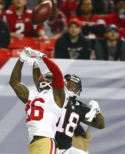 FILE - In this Dec. 18, 2016, file photo, then-San Francisco 49ers cornerback Tramaine Brock (26) breaks up the ball intended for Atlanta Falcons wide receiver Taylor Gabriel (18) during the second half of an NFL football game, in Atlanta. The Seattle Seahawks have added depth to their secondary by signing former San Francisco starting cornerback Tramaine Brock. Seattle added Brock to its roster Wednesday, Aug. 16, 2017, a day after meeting with him. (AP Photo/Butch Dill, File)
