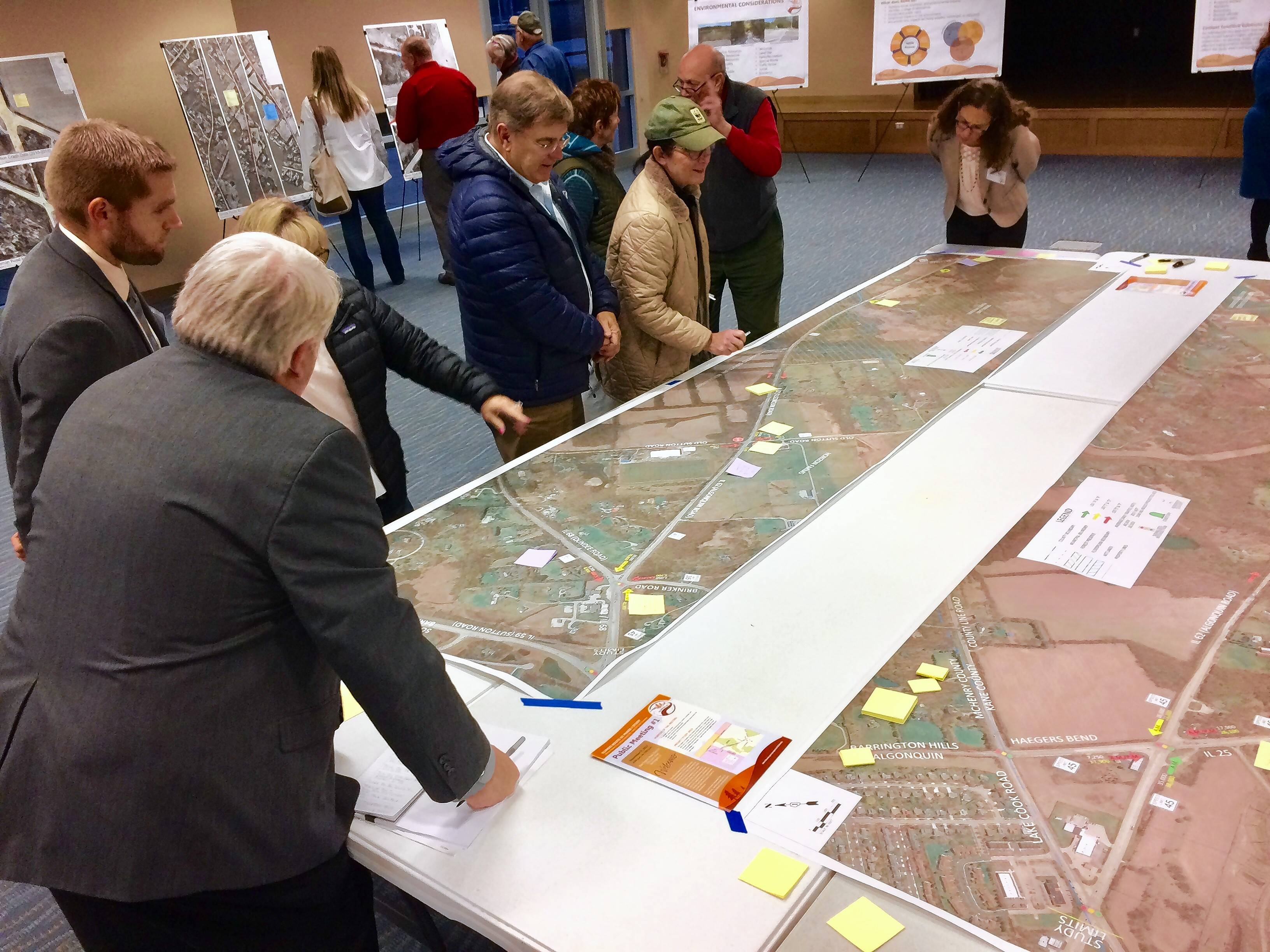 Planning has started for improvements to Algonquin Road through Barrington Hills, which Illinois Department of Transportation officials say would not begin for at least six years. Visitors here look at an image of Algonquin Road during a public information open house Thursday at Barrington Park District headquarters.