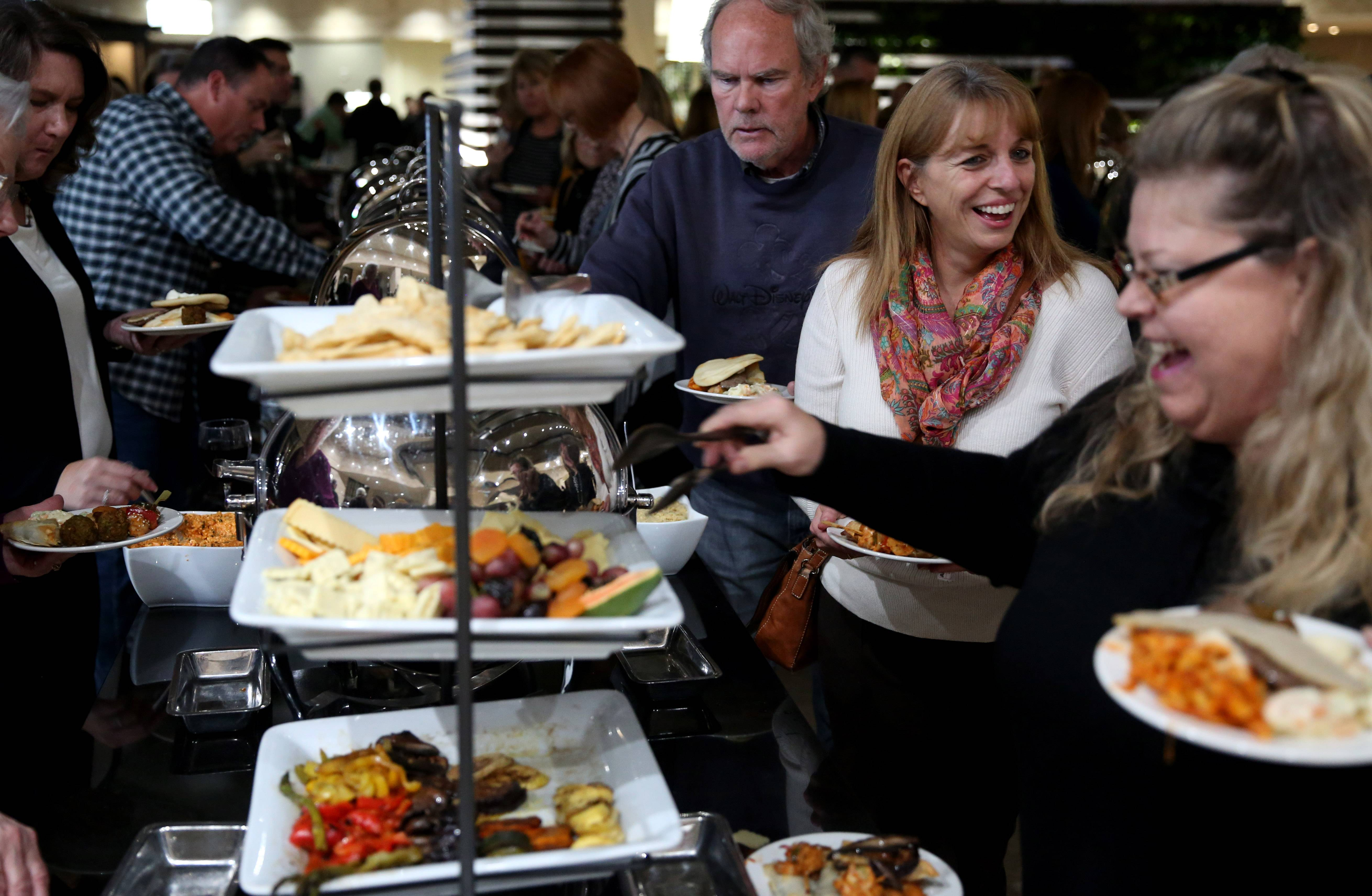 Those attending the  2017 Daily Herald Cook of the Week Challenge finale got to sample from a buffet. Laura Andrew, far right, was celebrating her birthday by attending the event to watch the final four cooks compete.