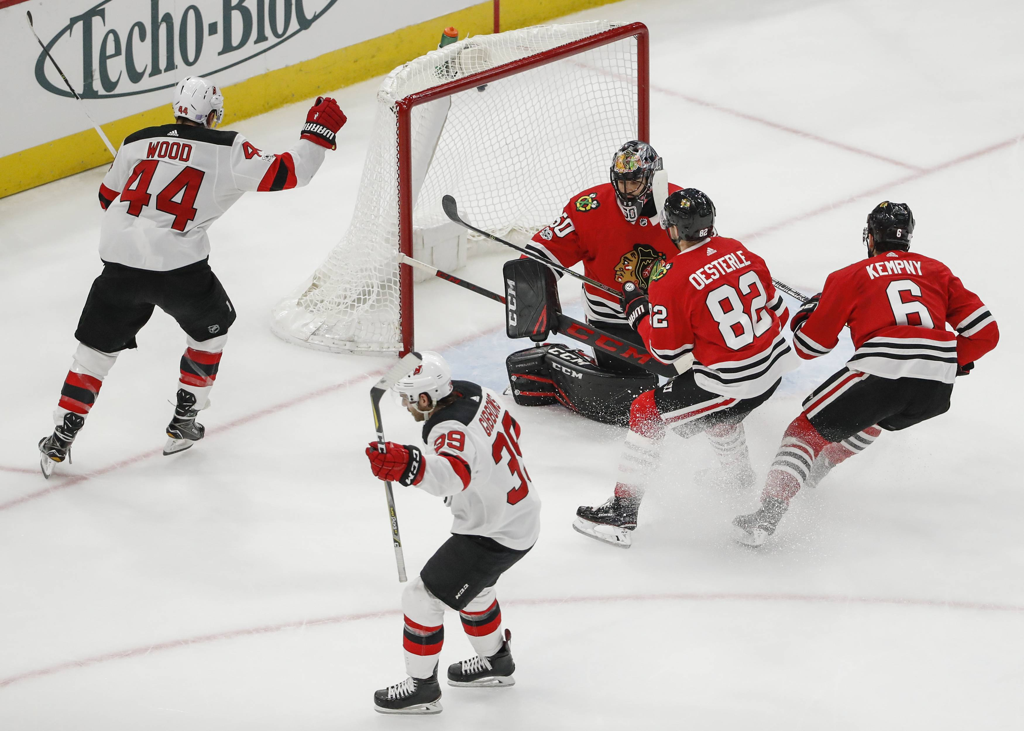 New Jersey Devils left wing Brian Gibbons (39) reacts after scoring against Chicago Blackhawks goalie Corey Crawford (50) during the second period of an NHL hockey game, Sunday, Nov. 12, 2017, in Chicago.