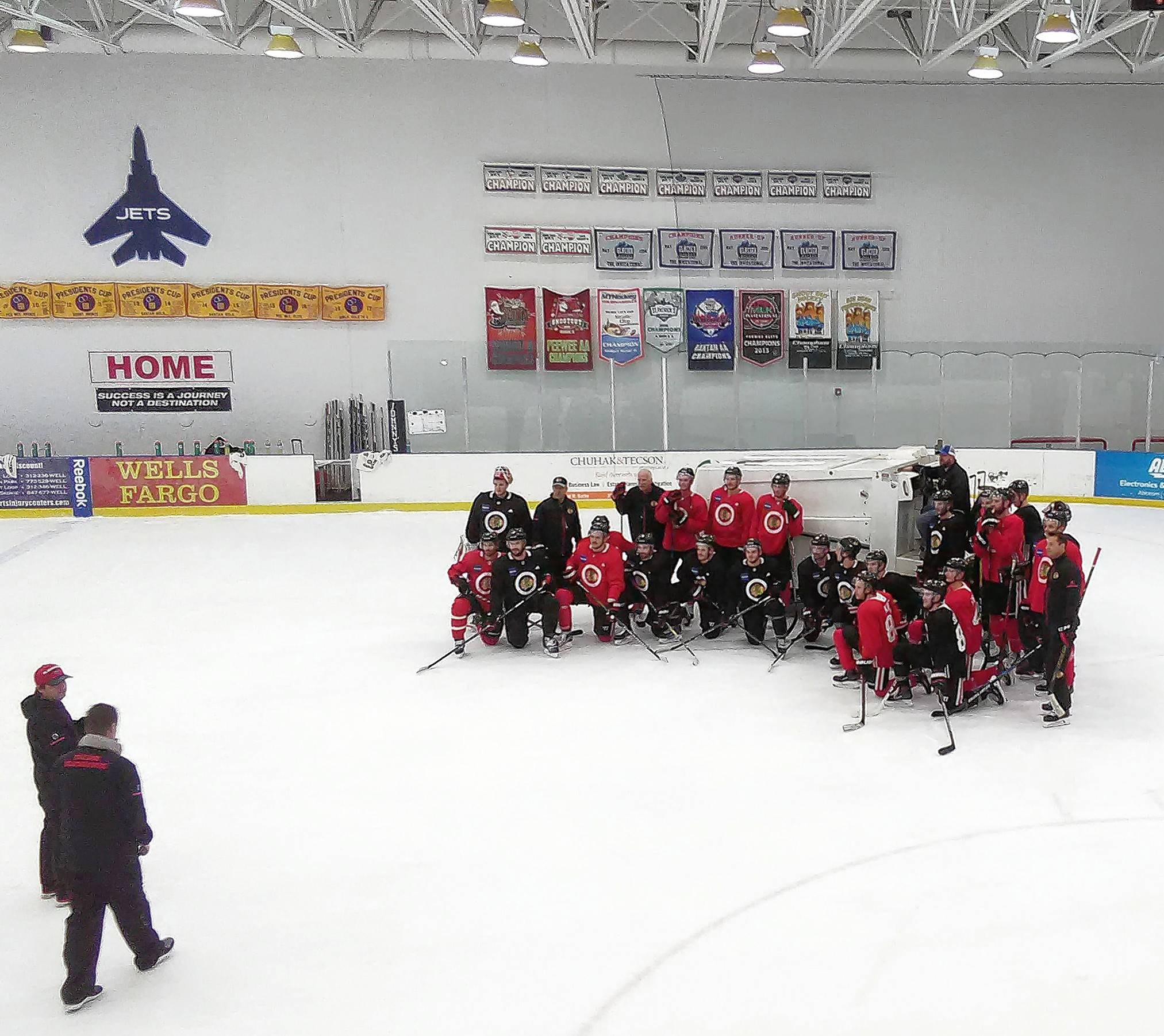 The Chicago Blackhawks gather for a photographic moment as they held their final practice at Johnny's IceHouse West. The team will now conduct practices at the new MB Ice Arena just south of the United Center.