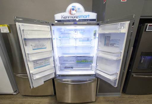 FILE - In this Thursday, July 20, 2017, file photo, the Kenmore Elite Smart French Door Refrigerator appears on display at a Sears store in West Jordan, Utah. Store chains watching the upheaval in retail are making strategic alliances. For example, the owner of Sears is selling Kenmore-branded appliances on Amazon in some markets.