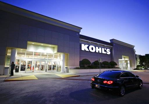 FILE - In this Tuesday, Aug. 22, 2017, file photo, a car drives by the entrance of a Kohl's department store in Orlando, Fla. Store chains watching the upheaval in retail are making strategic alliances. For example, Kohl's shoppers can find Amazon devices at some stores. For Kohl's, the Amazon partnership offers lots of potential: It pulls online and voice shoppers into the stores where they might pick up clothes or home items.