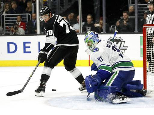 Vancouver Canucks goalie Anders Nilsson, right, blocks a shot by Los Angeles Kings left wing Tanner Pearson during the second period of an NHL hockey game in Los Angeles, Tuesday, Nov. 14, 2017.