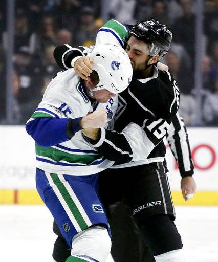 Los Angeles Kings left wing Andy Andreoff, right, and Vancouver Canucks right wing Derek Dorsett brawl during the first period of an NHL hockey game in Los Angeles, Tuesday, Nov. 14, 2017.