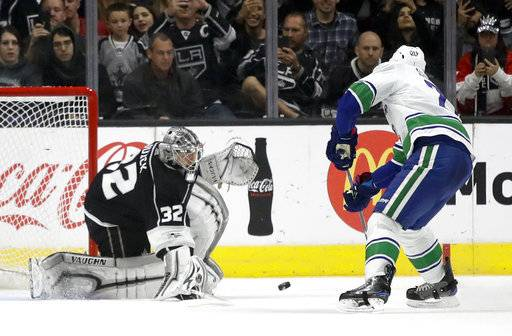 Los Angeles Kings goalie Jonathan Quick, left, blocks a a penalty shot by Vancouver Canucks center Brandon Sutter during the second period of an NHL hockey game in Los Angeles, Tuesday, Nov. 14, 2017.