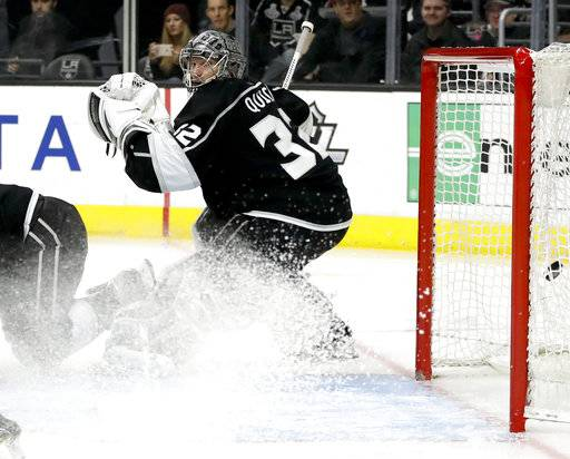 Los Angeles Kings goalie Jonathan Quick watches Vancouver Canucks left wing Sven Baertschi's goal during the third period of an NHL hockey game in Los Angeles, Tuesday, Nov. 14, 2017. The Canucks won 3-2.