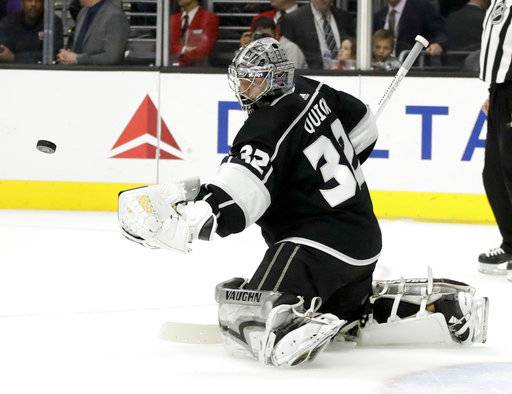 Los Angeles Kings goalie Jonathan Quick blocks a shot by the Vancouver Canucks during the first period of an NHL hockey game in Los Angeles, Tuesday, Nov. 14, 2017.