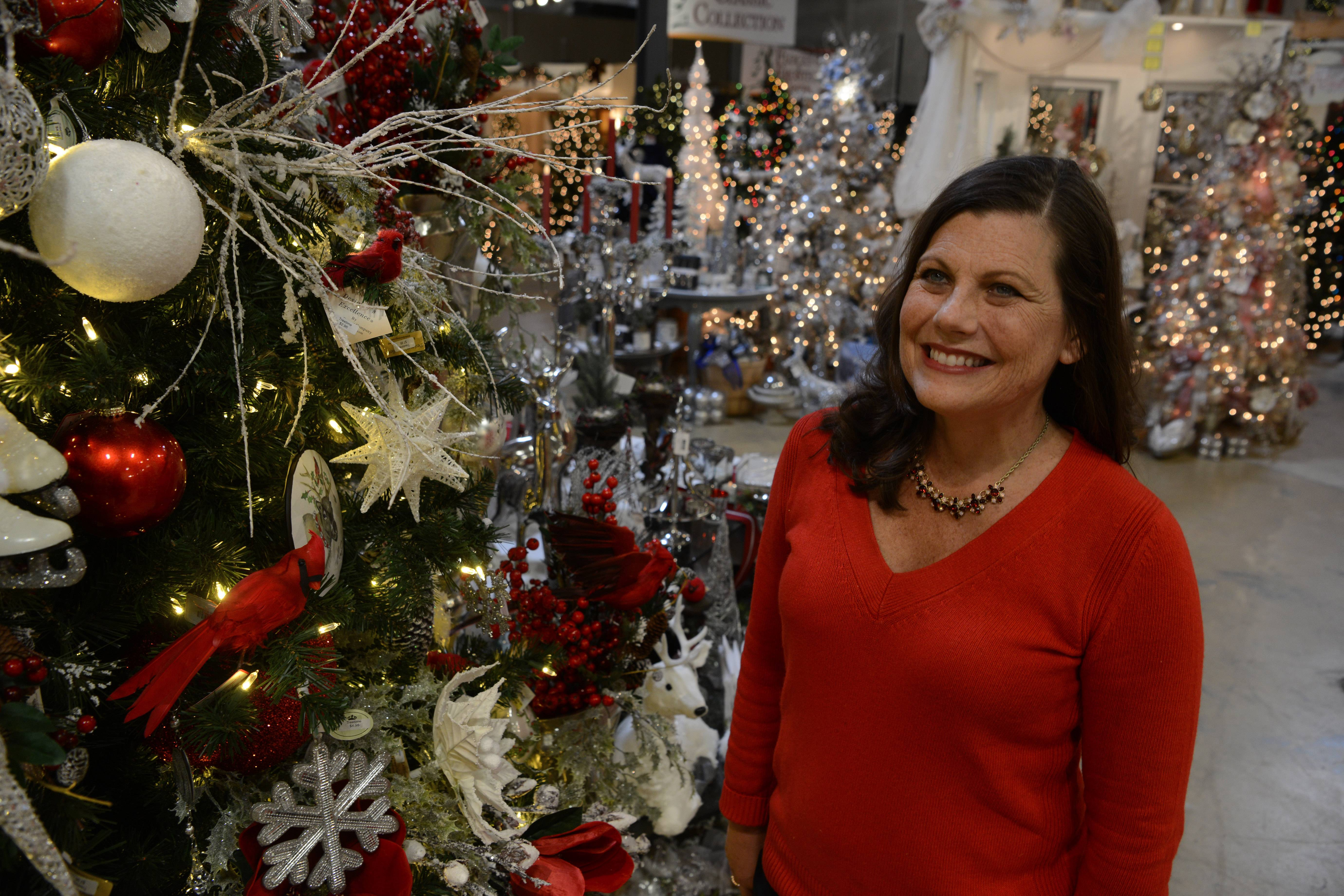 Treetime Christmas Creations owner Laurie Kane shows the Winter Garden artificial tree available at her shop in Lake Barrington.