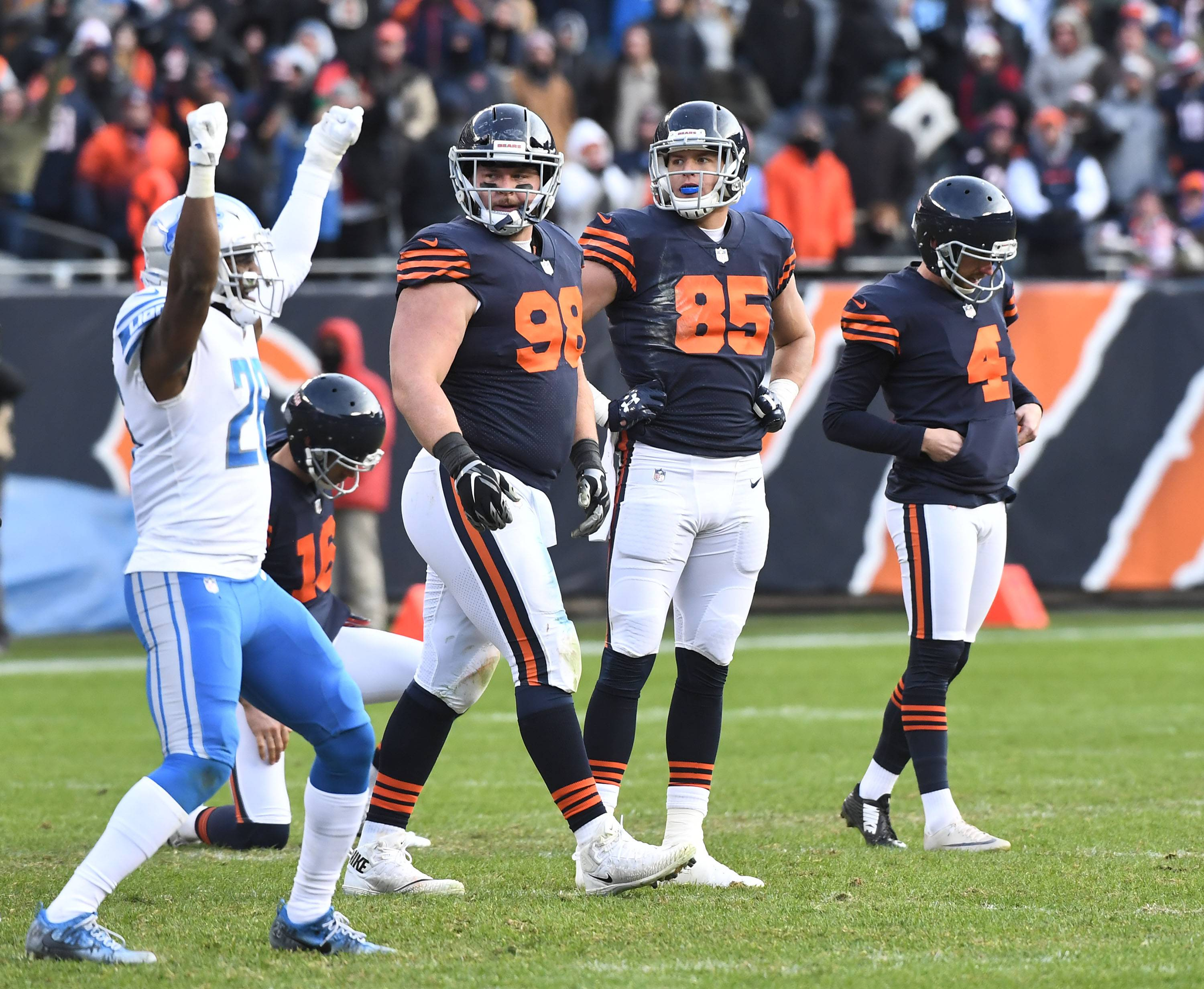 Chicago Bears kicker Connor Barth bows his head as teammates Mitch Unrein and Daniel Brown watch Detroit Lions safety Don Carey celebrate the missed field goal with only seconds left in regulation Sunday at Soldier Field in Chicago.