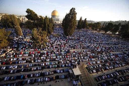 FILE - In this Sept. 24, 2015, file photo, Palestinians pray during the Muslim holiday of Eid al-Adha, near the Dome of the Rock Mosque in the Al Aqsa Mosque compound in Jerusalem's old city. U.S. officials say President Donald Trump will recognize Jerusalem as Israel's capital Wednesday, Dec. 6, 2017, and instruct the State Department to begin the multi-year process of moving the American embassy from Tel Aviv to the holy city. His decision could have deep repercussions across the region. (AP Photo/Mahmoud Illean, File)The Associated Press