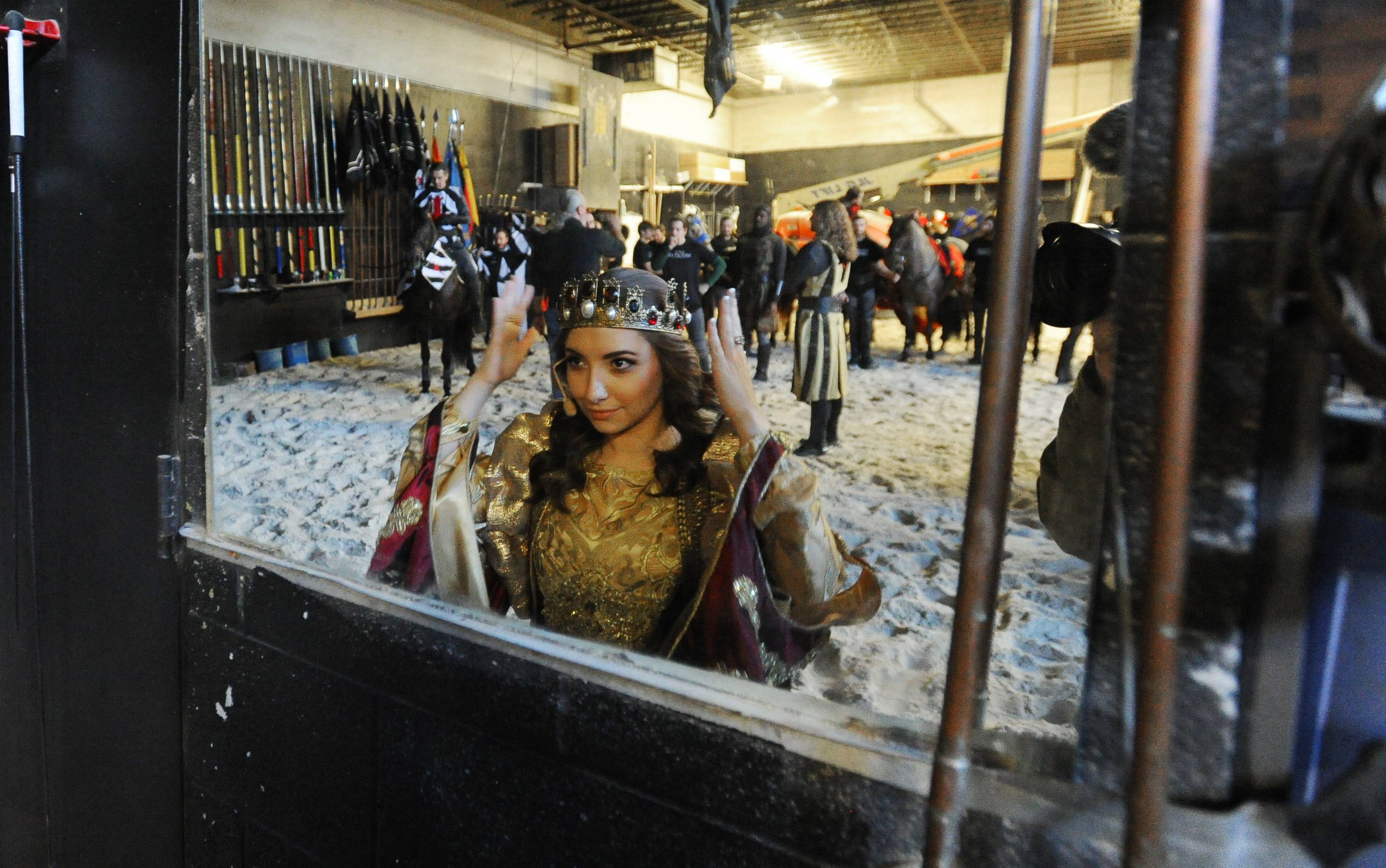 Sara Schubring, 24, prepares herself backstage for a new show at Medieval Times, where she will rule as queen.