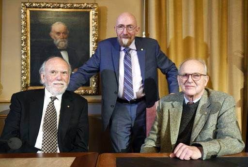 Nobel Laureates in Physics 2017 from left, Barry Barish, Kip Thorne and Rainer Weiss at the Royal Academy of Science in Stockholm, Thursday Dec. 7, 2017. (Pontus Lundahl/TT via AP)