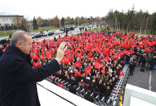 "Turkey's President Recep Tayyip Erdogan waves to a group of workers at the airport in Ankara, Turkey, Thursday, Dec. 7, 2017 prior to his departure on a two-day official visit to Greece. Erdogan accused U.S.President Donald Trump of throwing the Middle East into a ""ring of fire"" by declaring the divided holy city of Jerusalem as Israel's capital.The Turkish leader said, addressing Trump: ""It's not possible to understand what you are trying to get out of it."".(Kayhan Ozer/Pool via AP)"