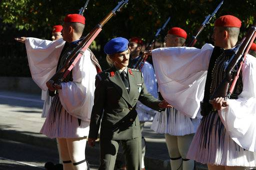 A Greek Presidential Guard officer inspects the evzones prior to the official welcome ceremony for Turkey's President Recep Tayyip Erdogan, in Athens, Thursday, Dec. 7, 2017. Erdogan is in Greece on atto-day official visit.