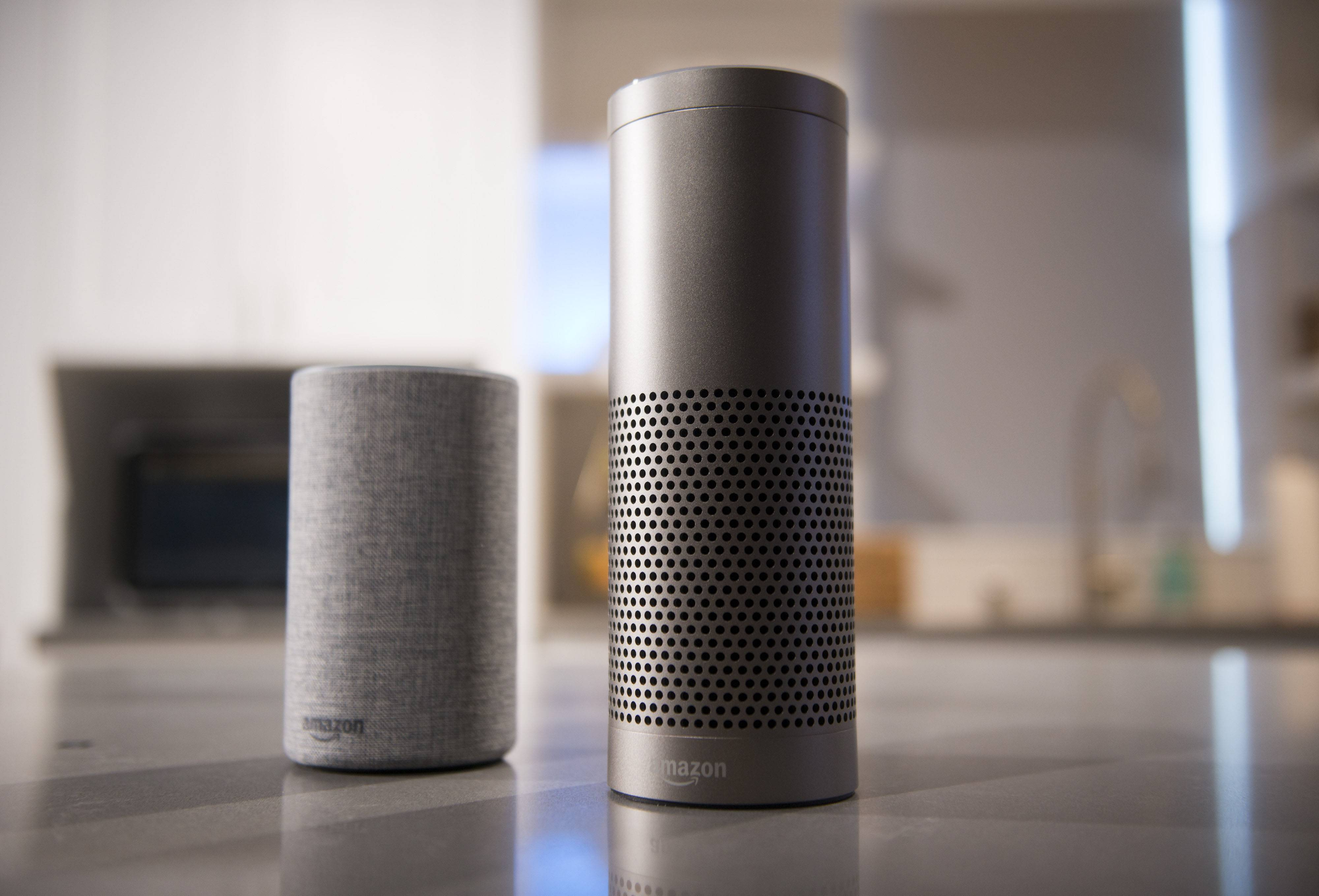 The Amazon.com Echo (left) and Echo Plus in Seattle, Washington, on Sept. 27, 2017.